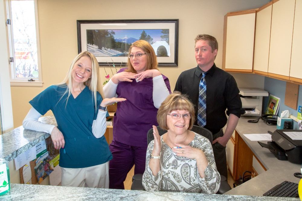 The team behind the desk at DK Dental Care