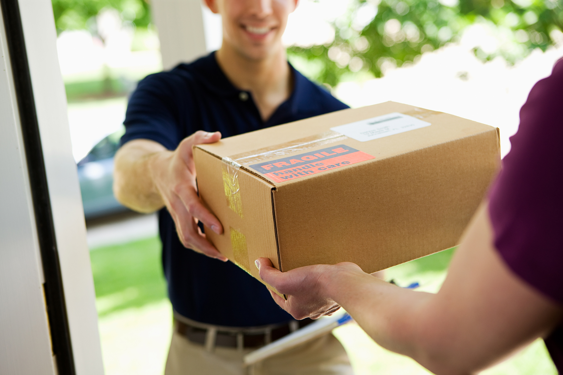 courier-delivering-package-home