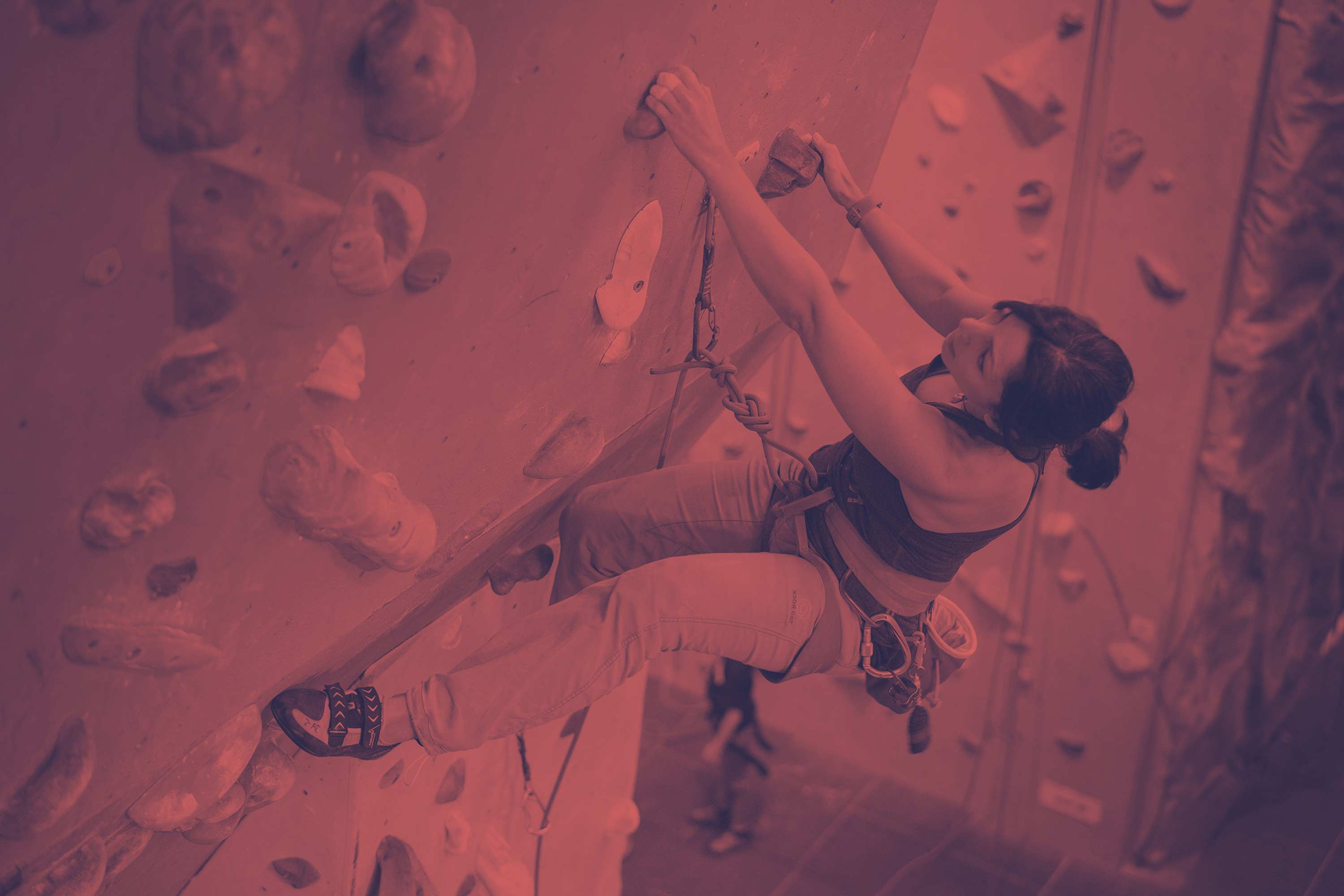 Woman at The Reach, lead climbing