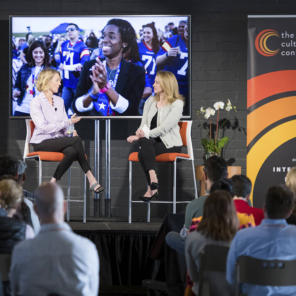 2 women on stage during a Q&A session