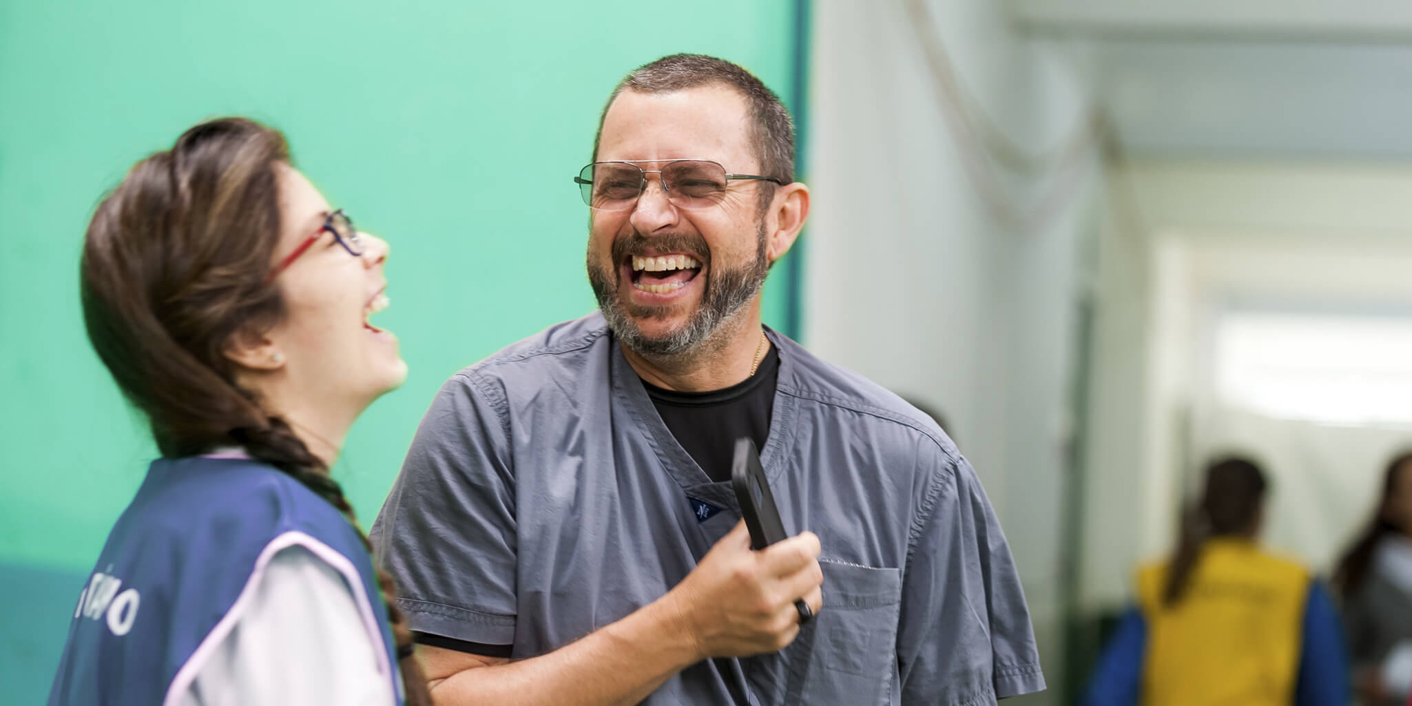 Dr. Dunham and a volunteer laughing