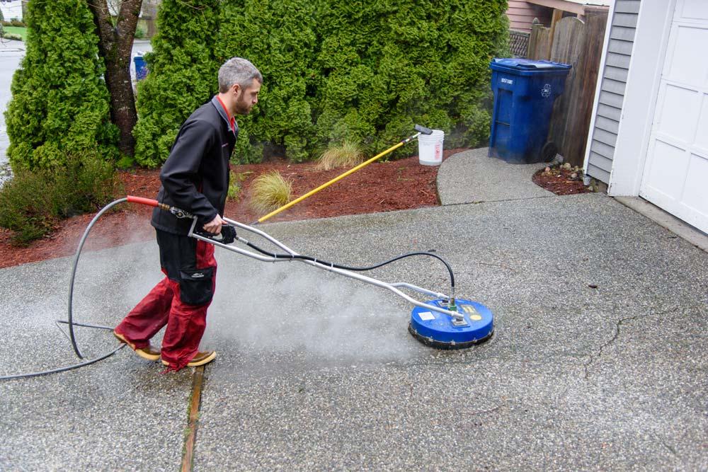 Pressure washing driveway in the North Puget Sound