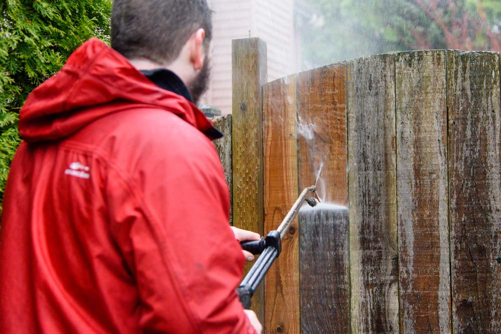 Pressure washing fence in the North Puget Sound