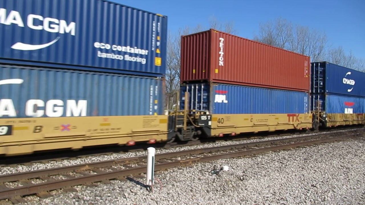 Train full of 40' containers moving west.