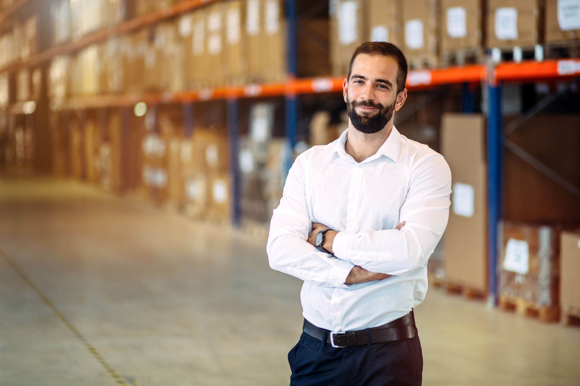 Logistics professional stands in a warehouse