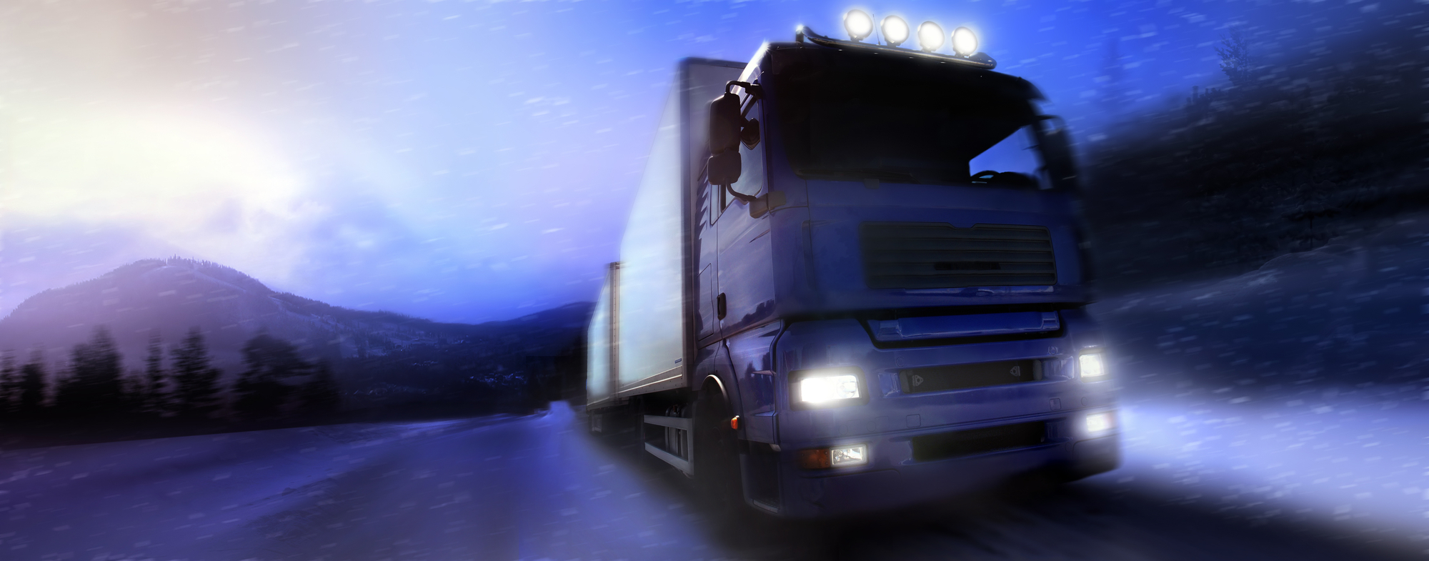 Truck driving at night in the snow