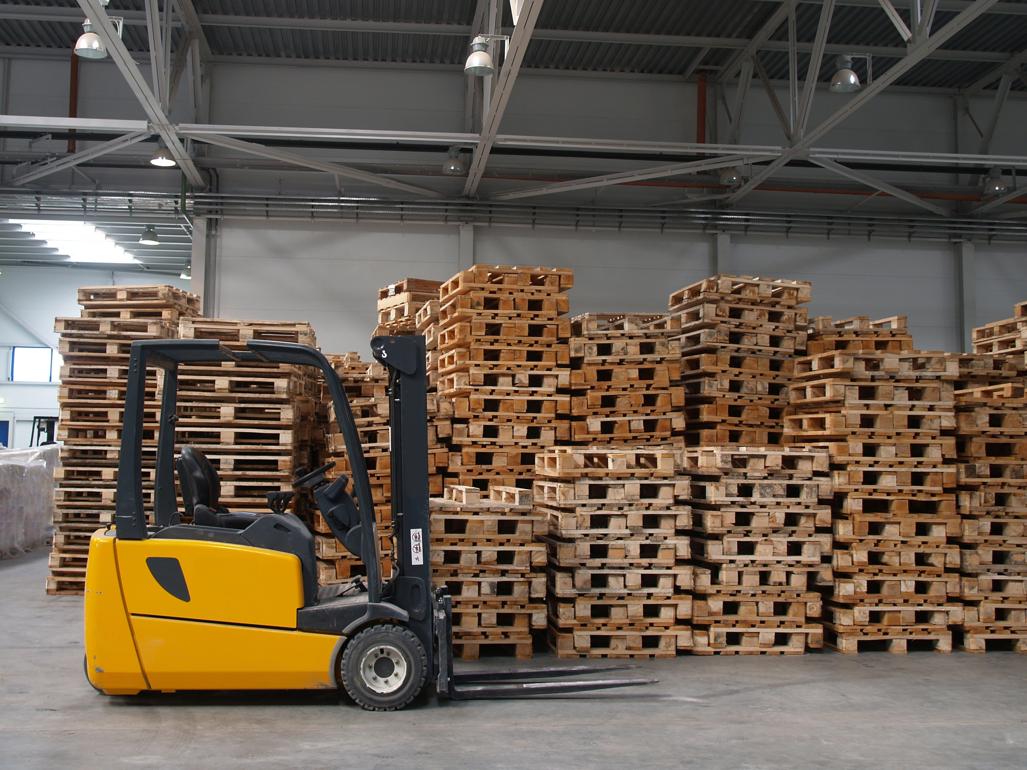 Pallets in a warehouse with a forklift