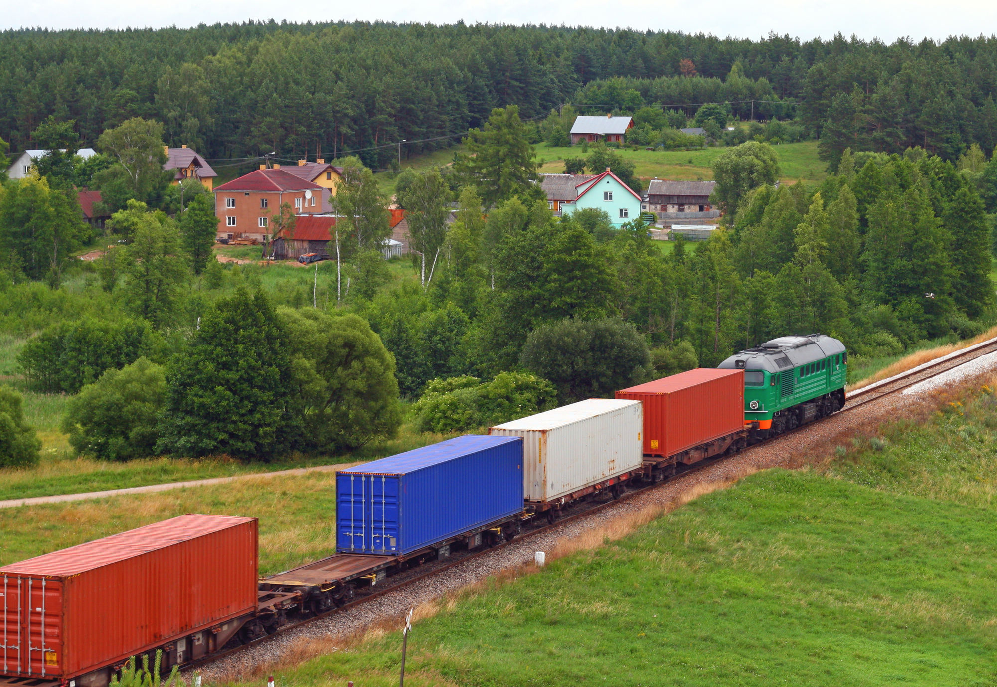 A train pulls containers across the country