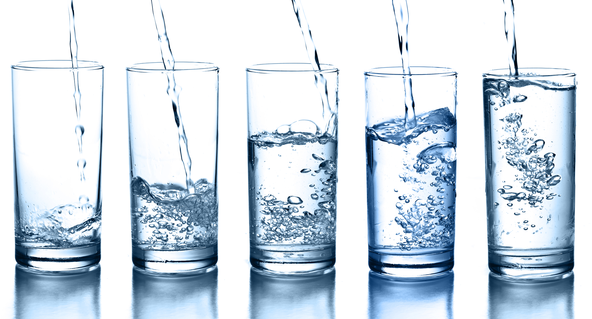 Glasses of drinking water getting filled