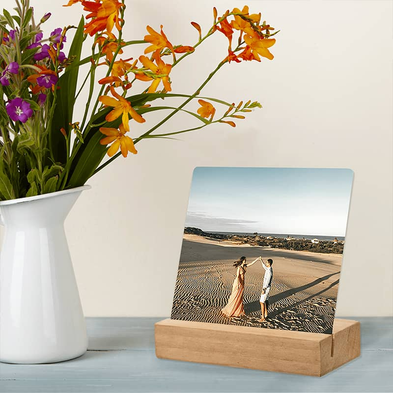 Order a metal photo print for your desk complete with wooden block