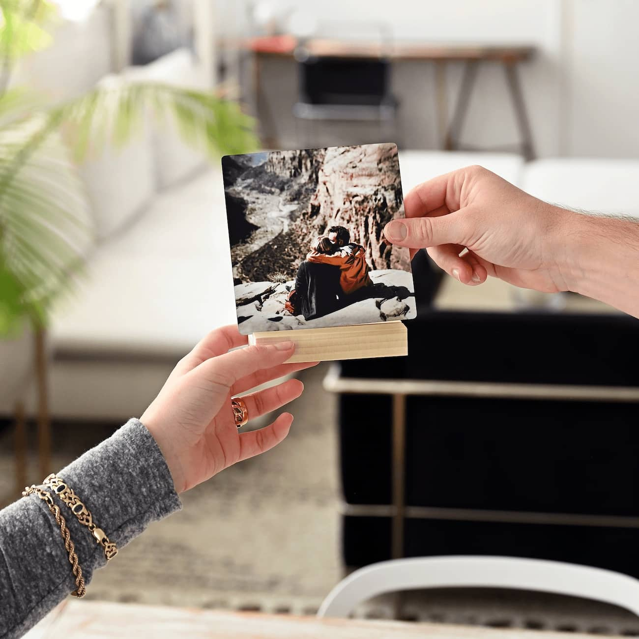 Metal photo desk prints on a wooden block