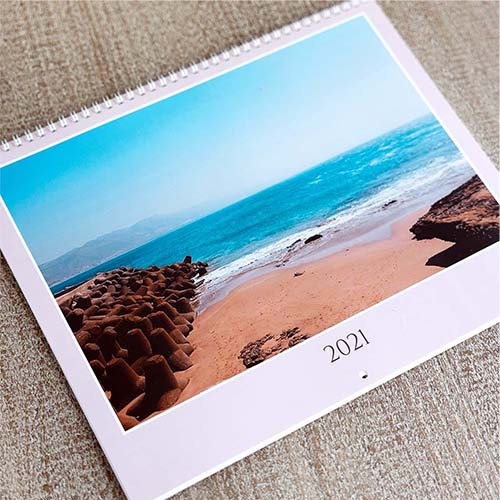 Create a printed photo calendar in 12 to 24 month formats for your wall