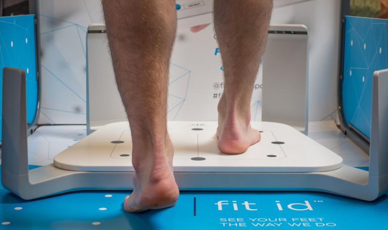 Person getting scanned at a Fleet Feet store with Volumental's 3D foot scanner