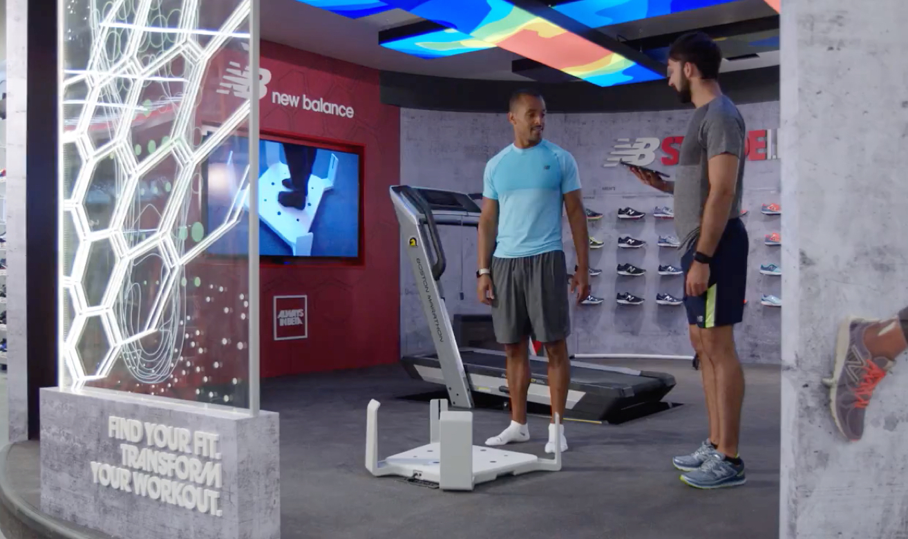 A person getting scanned in a New Balance store with Volumental's foot scanner