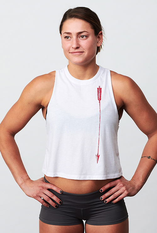 A woman wearing the Quivr Women's Racerback Tank.
