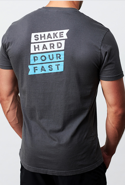 A man wearing the Quivr Unisex Grey Shake Hard Pour Fast Tee.