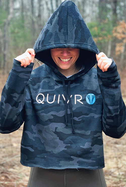 A woman wearing the Quivr Unisex Grey Arrow Tee.