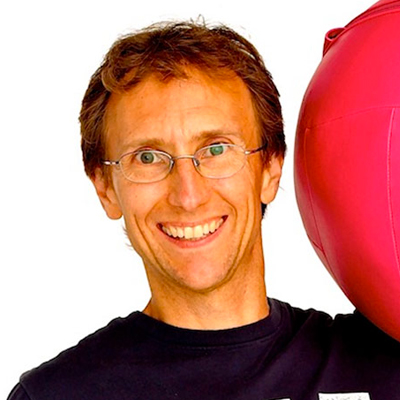 Smiling man with exercise ball