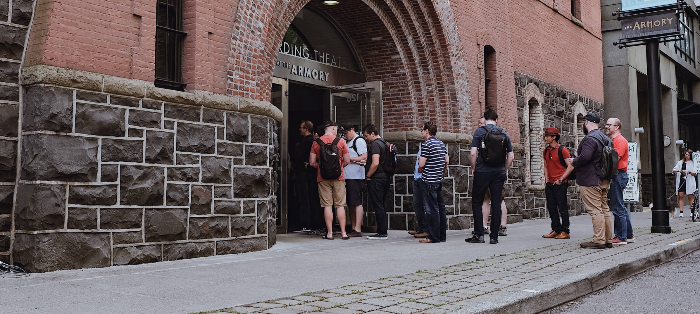 Attendees waiting on sidewalk outside of the Armory venue