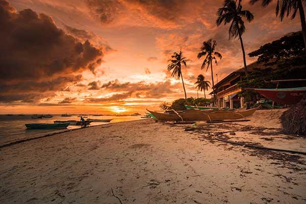sunset on the beach CBD sun salve