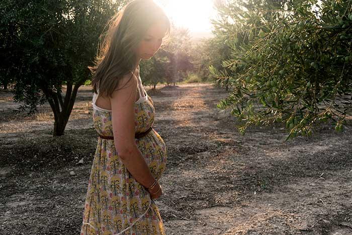 pregnant women in trees sunset pretty boho dress