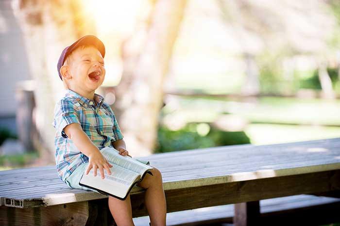 kid outside sunshine reading healthy