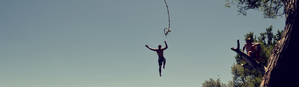 man jumping from a rope swing representing a high sex drive