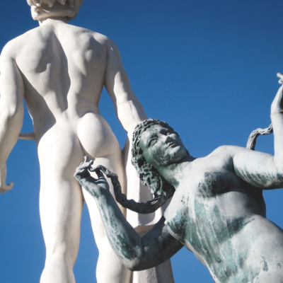 woman statue that looks like it's fingering the anus of another statue