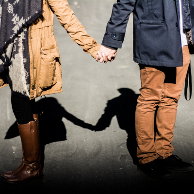 couple holding hands to suggest mending a sexless relationship