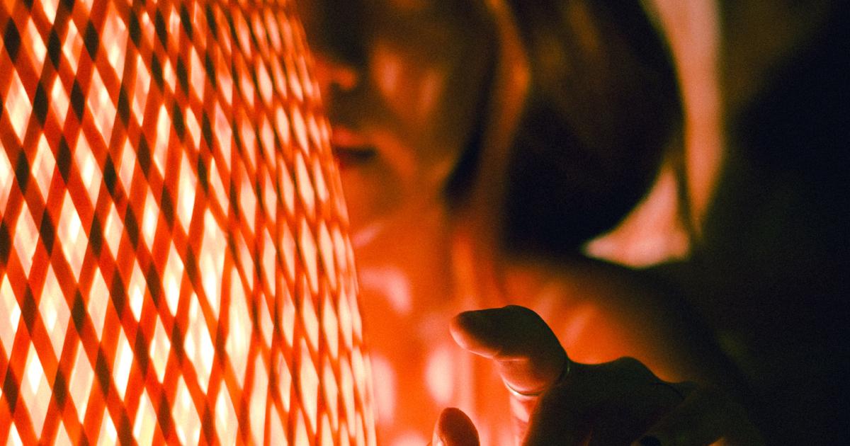 women touching a light