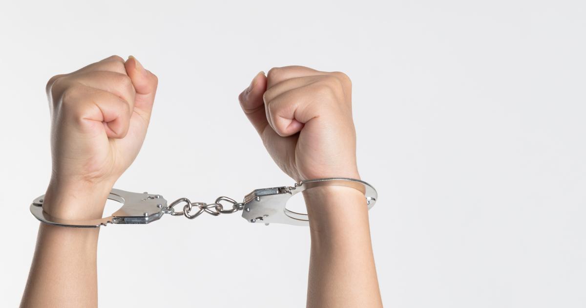 hands in cuffs