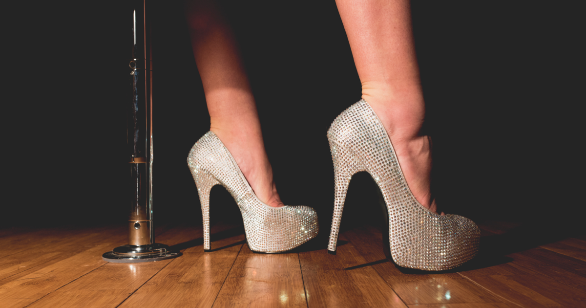 feet wearing sequin heels on a stage