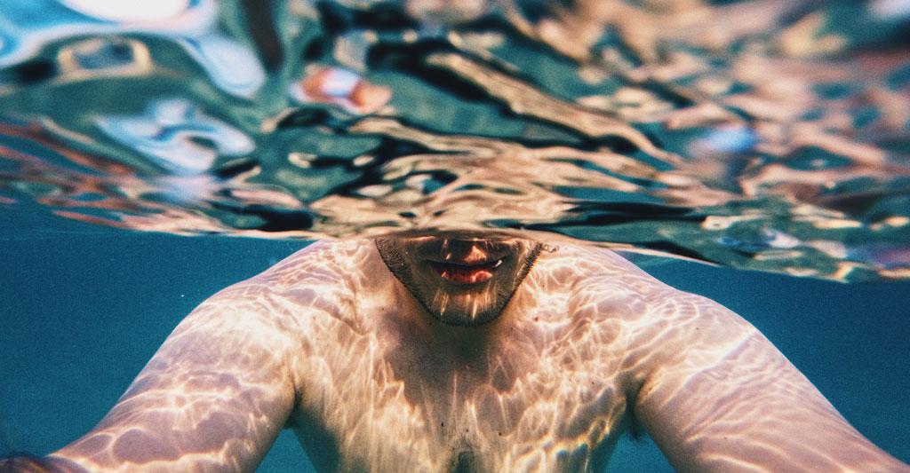 man swimming representing navigating a high sex drive
