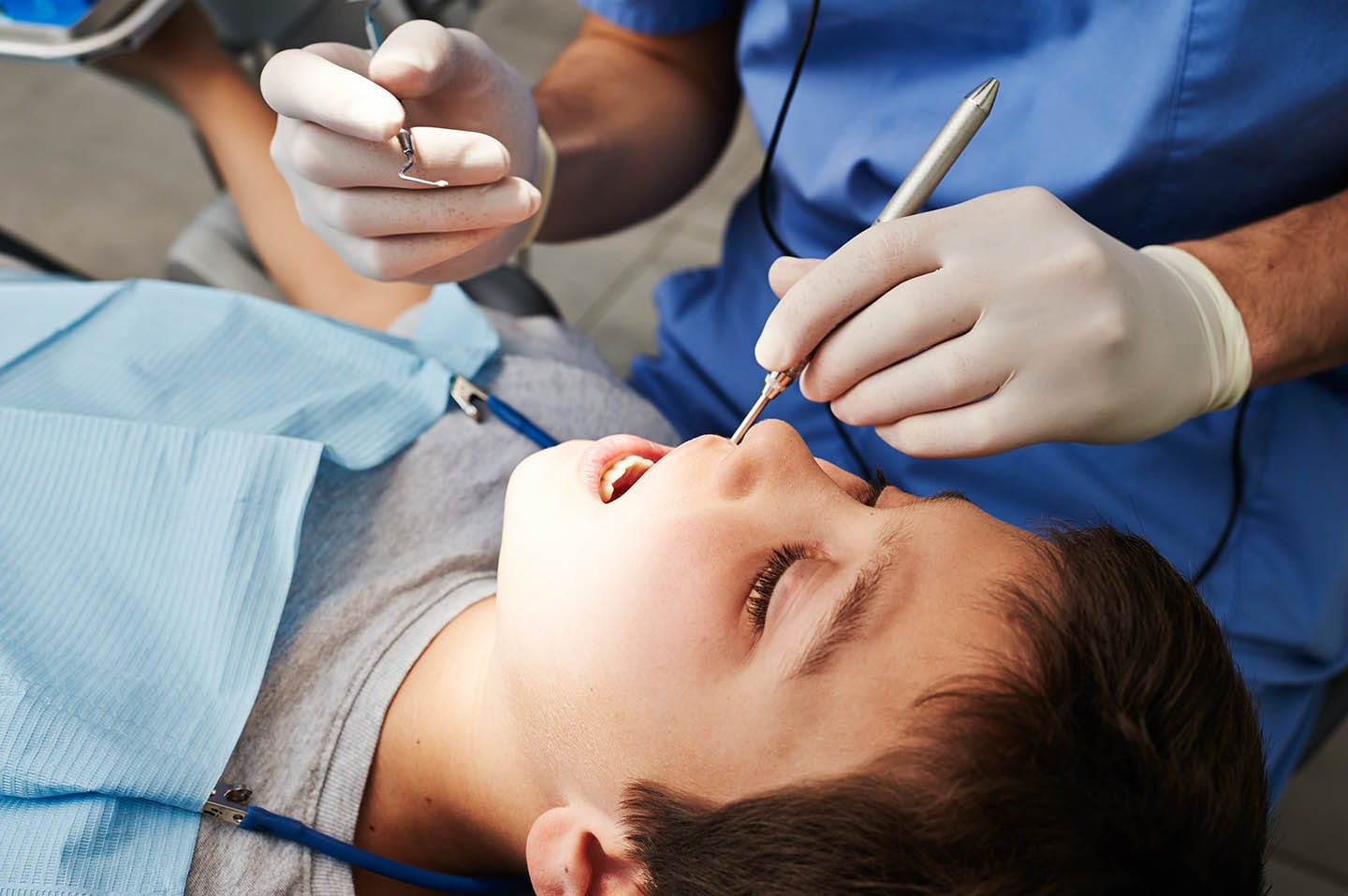 Child receiving dental cleaning