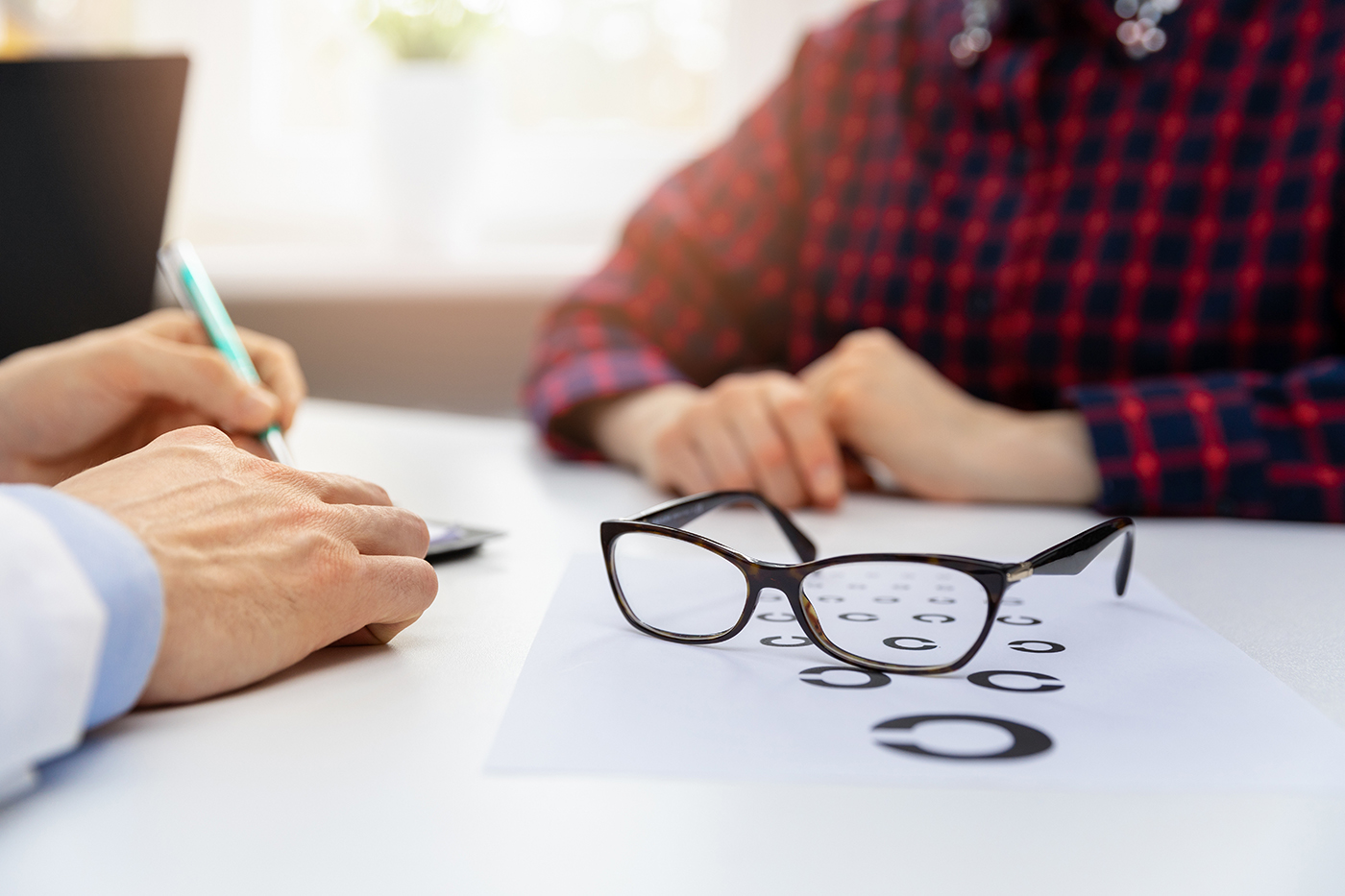 doctor patient interaction with glasses on table