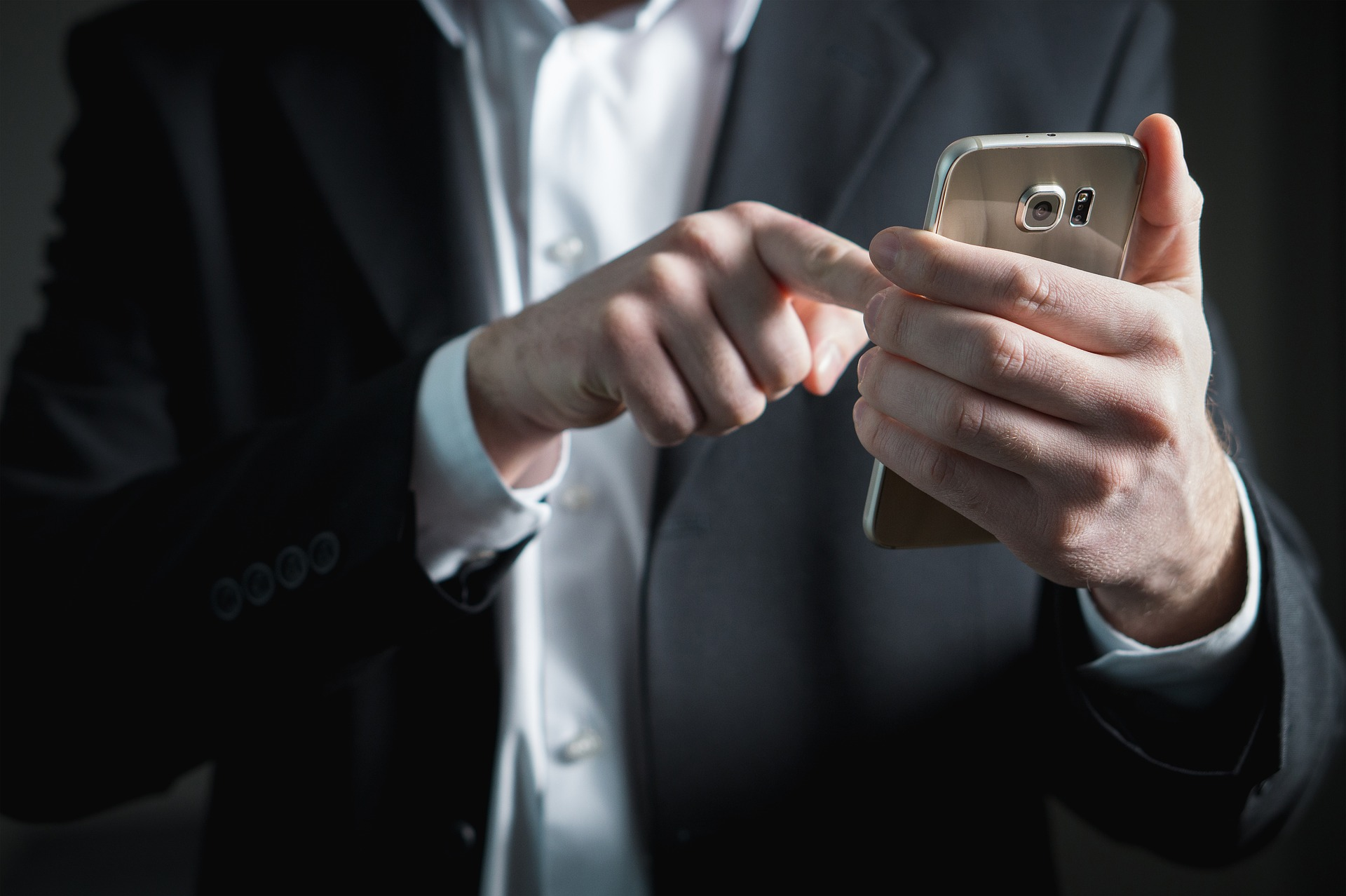business man with smartphone in the hand