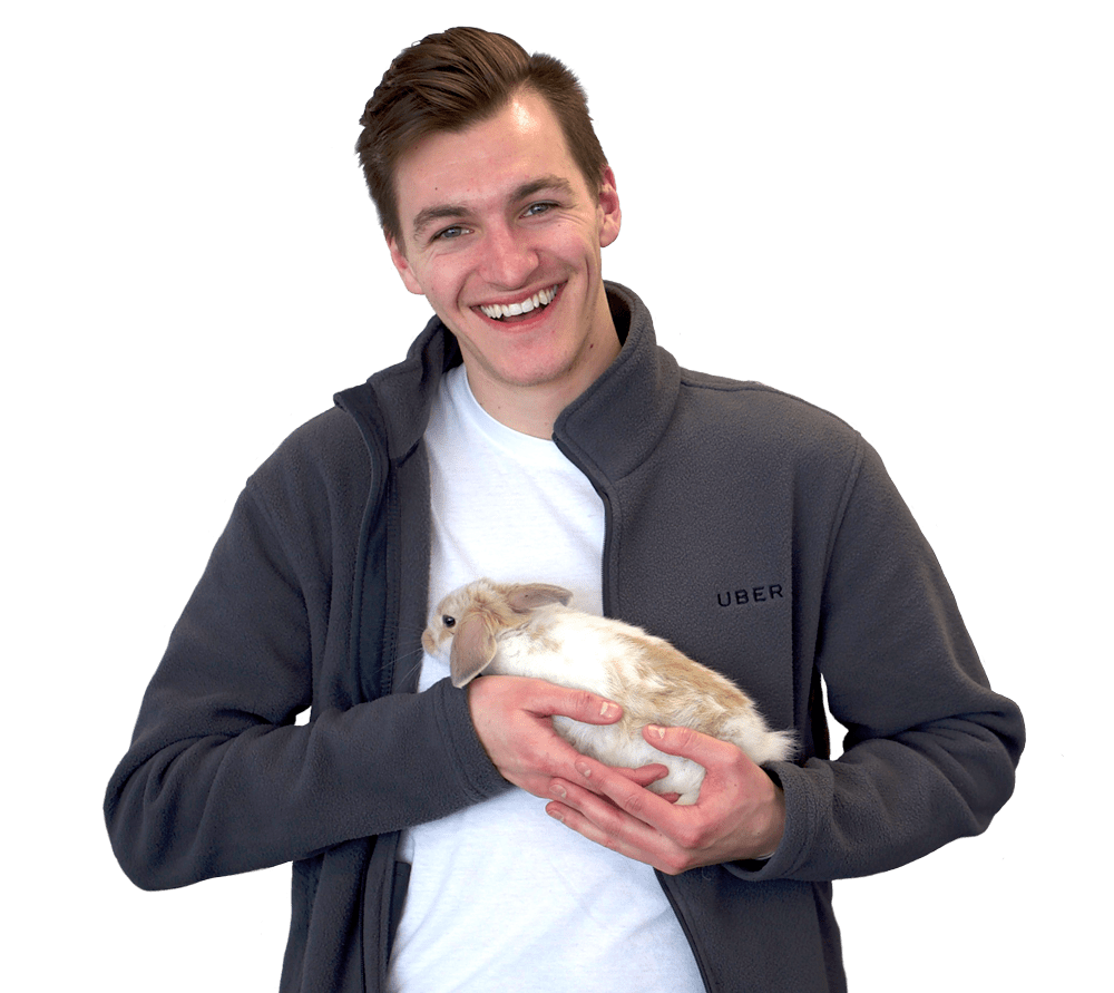 Calvin, an Uber employee holding a rabbit and commenting on the benefits of Hoppier as their office snack vendor