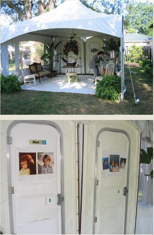 porta potties inside of a white tent with greenery and seating at a wedding