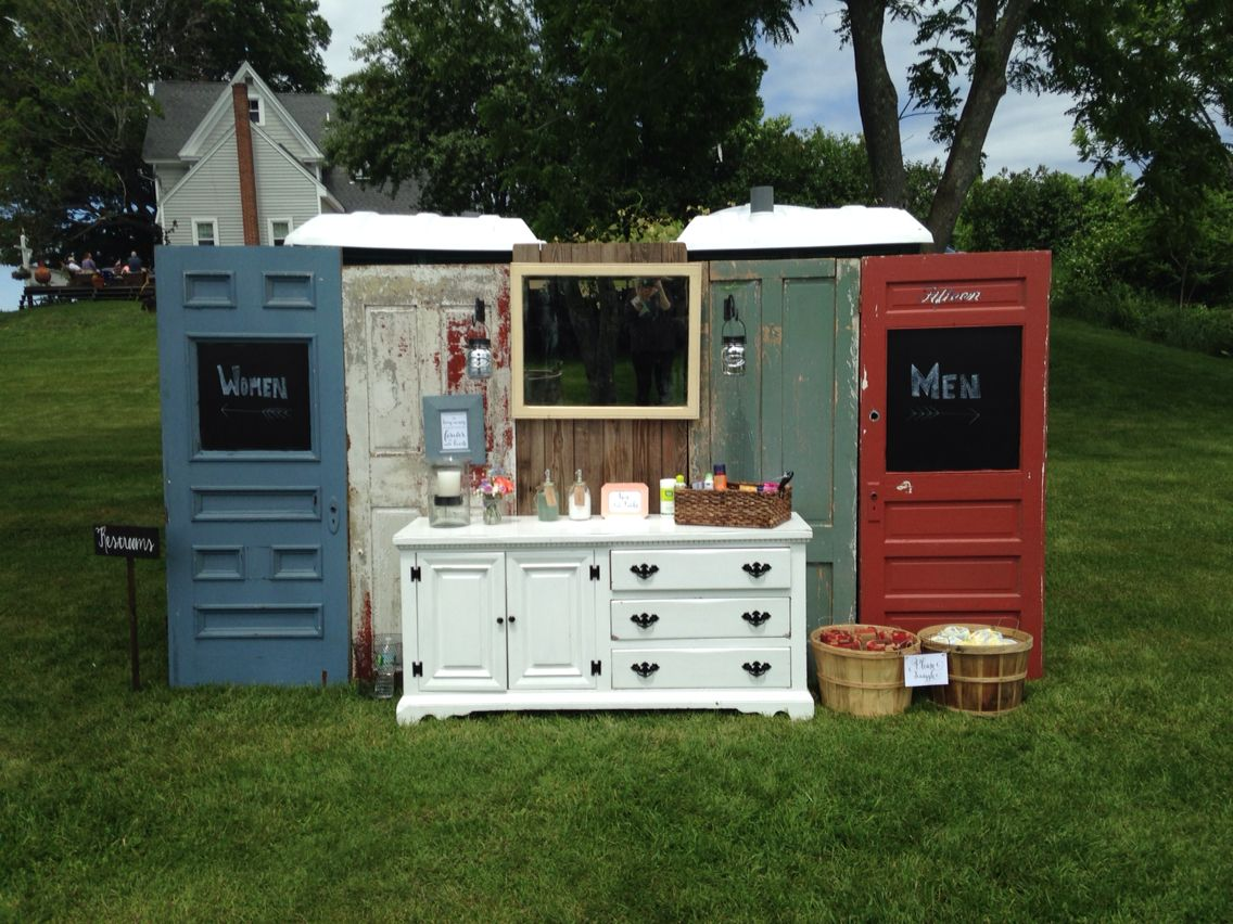 rustic doors and a cabinet covering up two porta potties