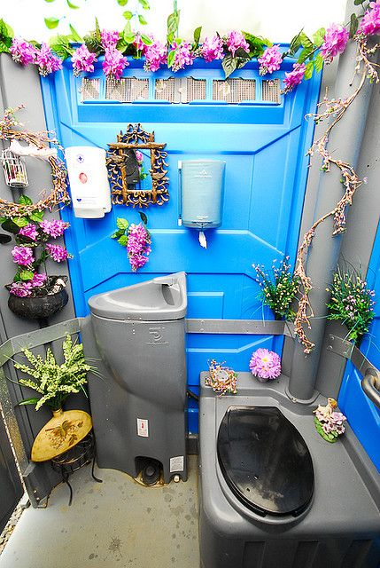 floral design inside of a porta potty for a wedding