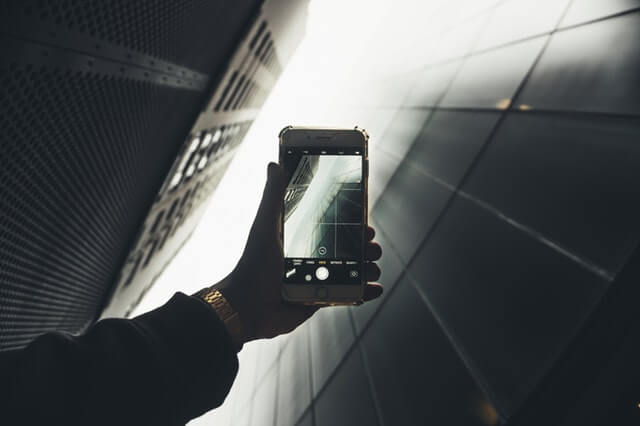 A Smartphone taking a picture of a skyscraper