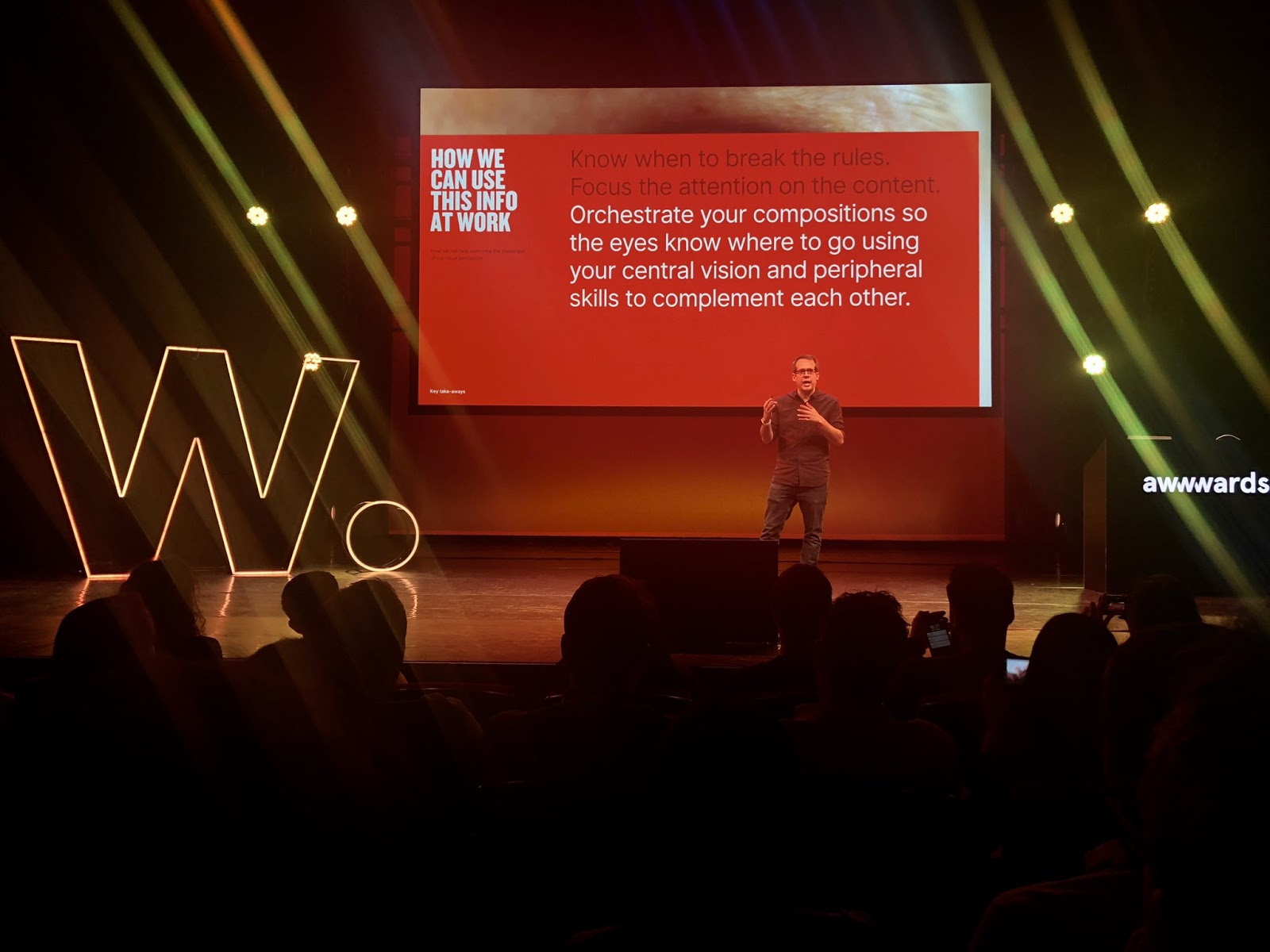 A speaker in the 2019 Awwwards Conference in Amsterdam stage