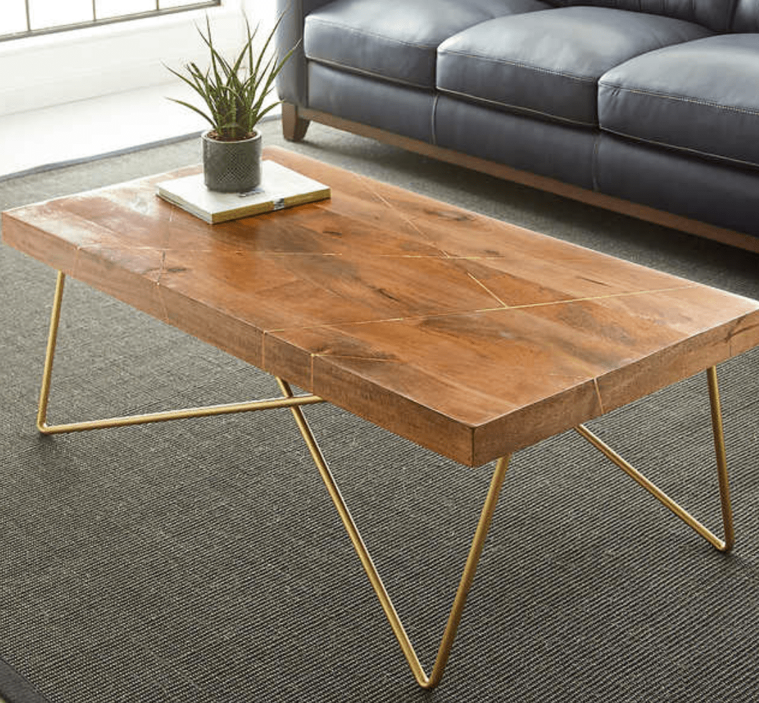 Spring for a solid coffee table to help center the other office decor in your workspace.