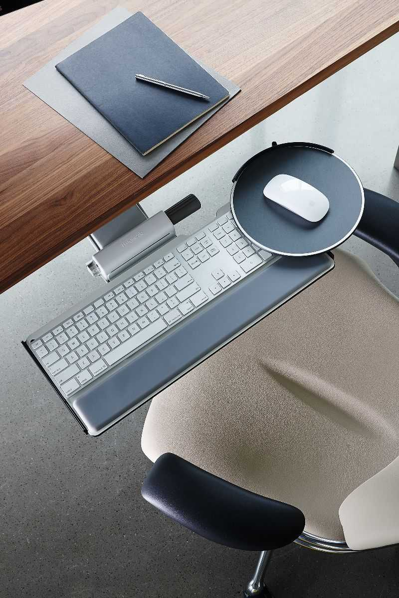Save some space with a keyboard tray, so you can fit more of these desk organization ideas!