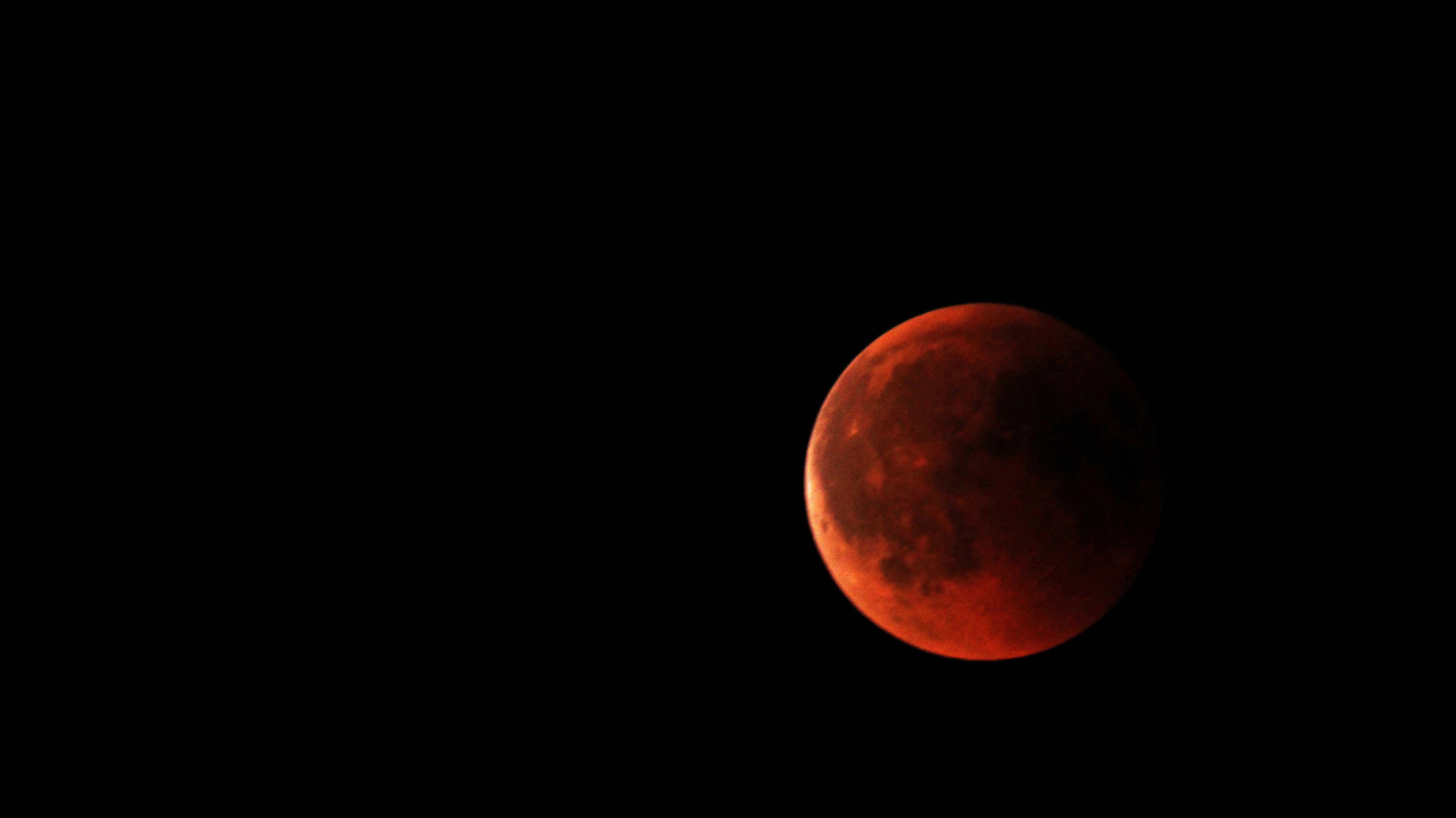 Take a lot of photos of the blood moon as it moves across the sky