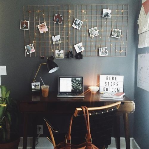 Create a whimsical look with stringlights as a creative way to display photos without frames