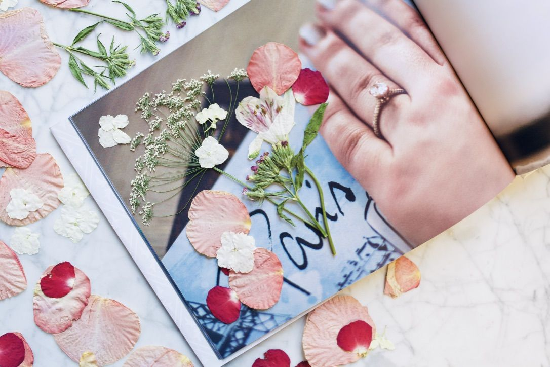 One of many romantic gift ideas is to press flowers into a photobook