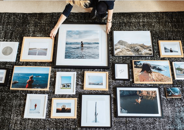 Plan the layout of your gallery wall on the floor first before hanging it