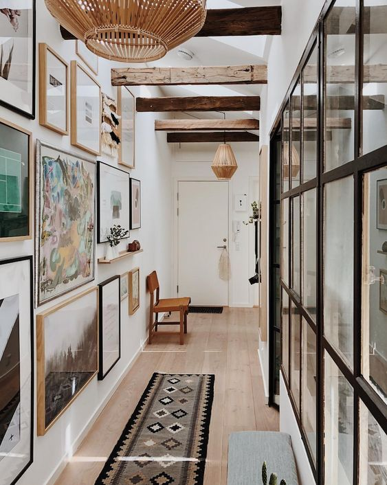Hallways make an excellent space to hang a gallery wall in your home