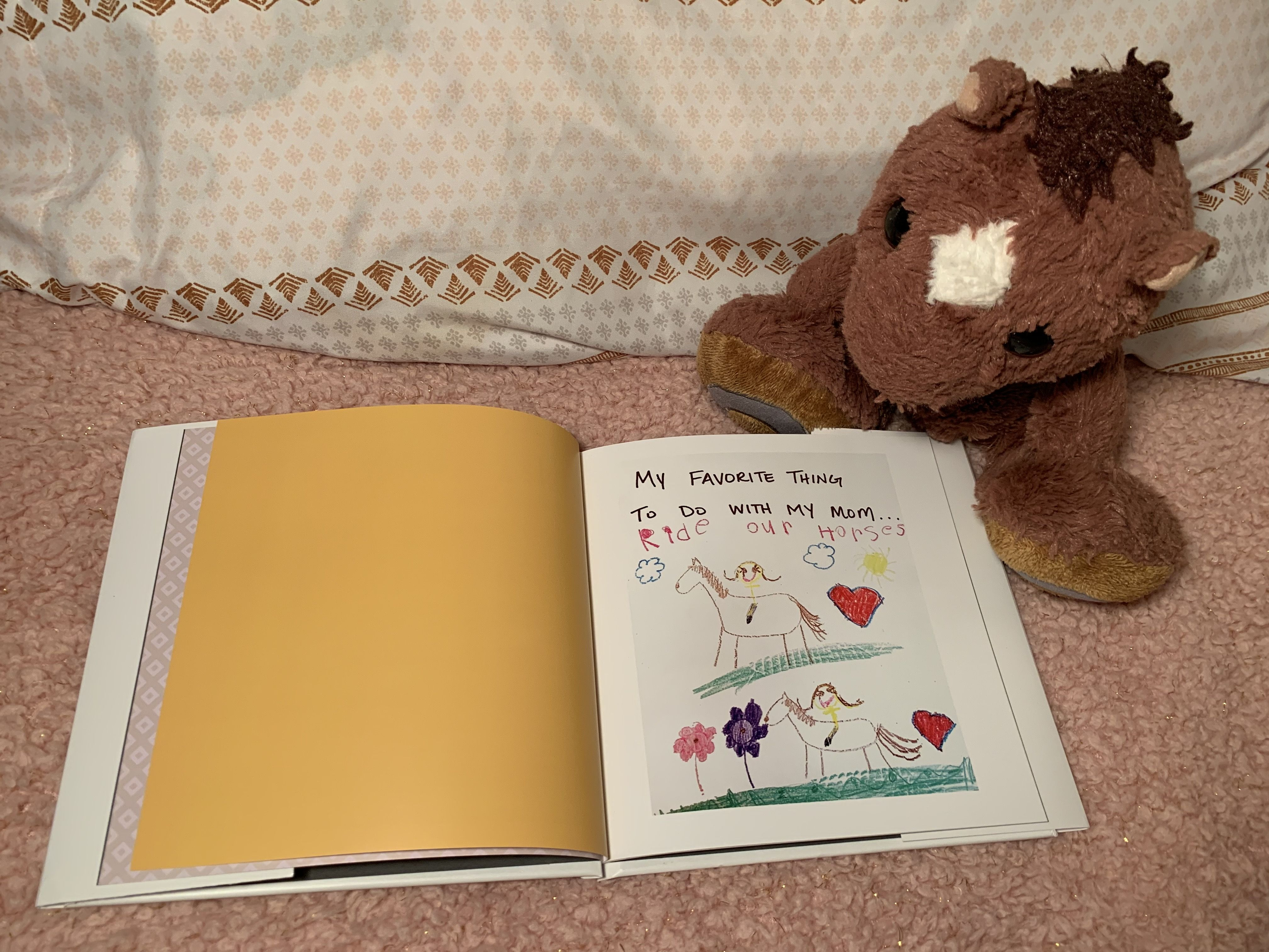 Snap or can your children's artwork to make an illustrated photo book